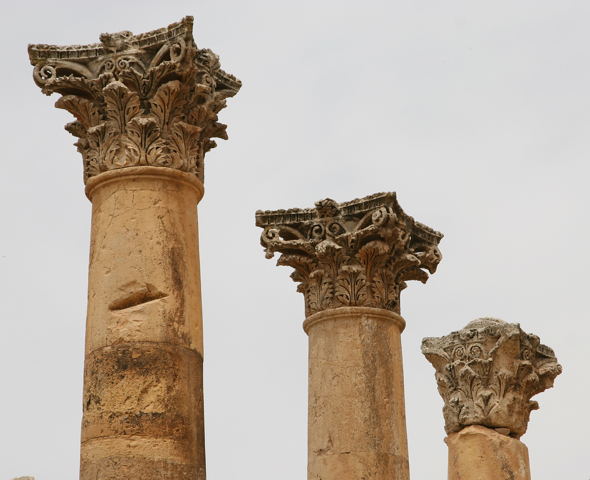 Jerash - The ornate tops to three columns on the Cardo Maximus.