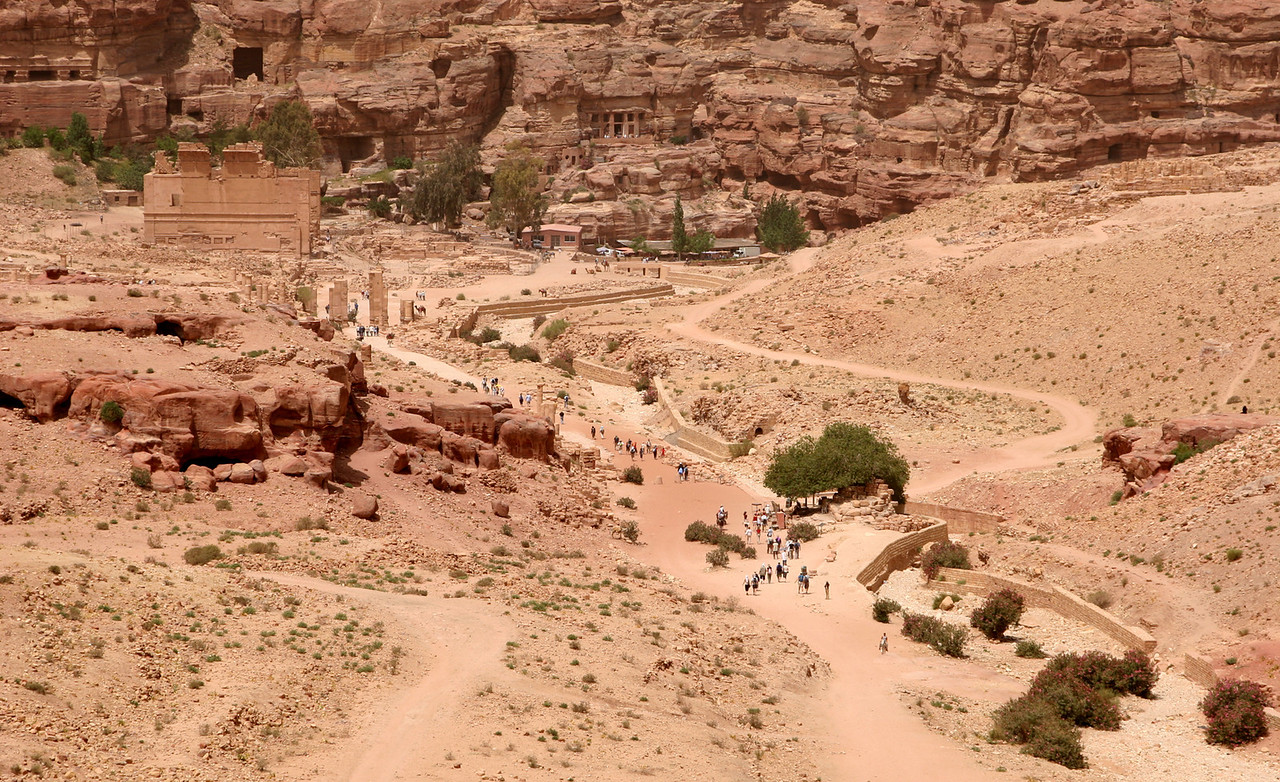Petra - A view of the city area showing the valley floor, tombs cut into the rock, and Qasr Al-Bint (the large free-standing building) which was a temple built for the Nabataean god Dashara.