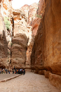 Petra - The Siq - Channels were cut into the walls on both sides of The Siq to bring water into the city of Petra.  In some places the channels are open, and in other places the 2000 year old terracotta pipes are still visible.  The original Roman paving also remains in some places (as seen in this photo).