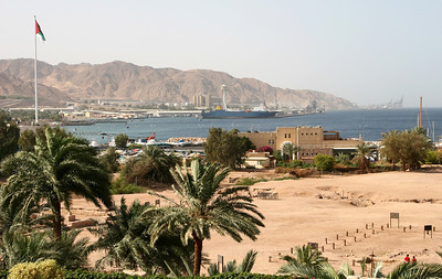 Aqaba - View of the Aqaba port, Ayla (Old Aqaba) ruins and the 'Great Arab Revolt' flagpole from my hotel window.