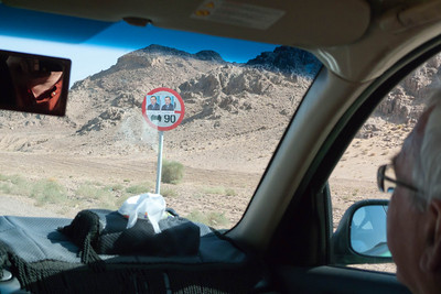 On road to Wadi Rum: Road signs plastered with election posters. (Running on road safety platform?)