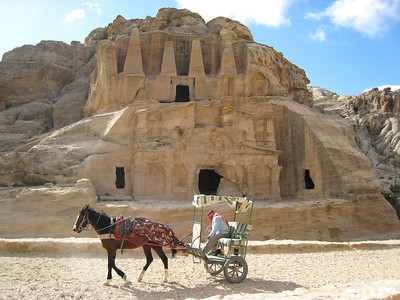 Horse and carriage for tired visitors.  The temples, tombs and buildings were carved by the Nabateans a nomadic tribe originally from Yemen, who settled in the Petra area around 300BC.