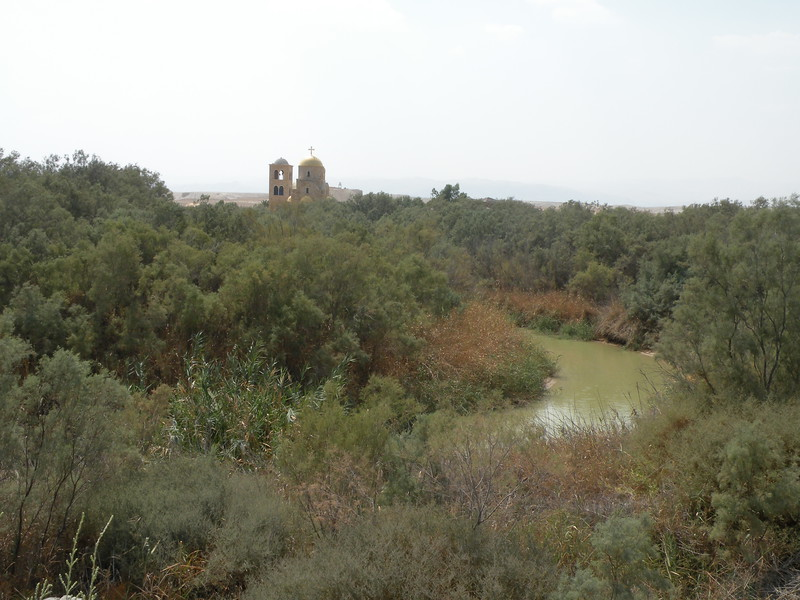 The walking trail passes a golden-roofed Greek Orthodox church and under the watchful eye of border guards to the Jordan River.