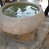 Baptismal font with filtered water from the River Jordan.