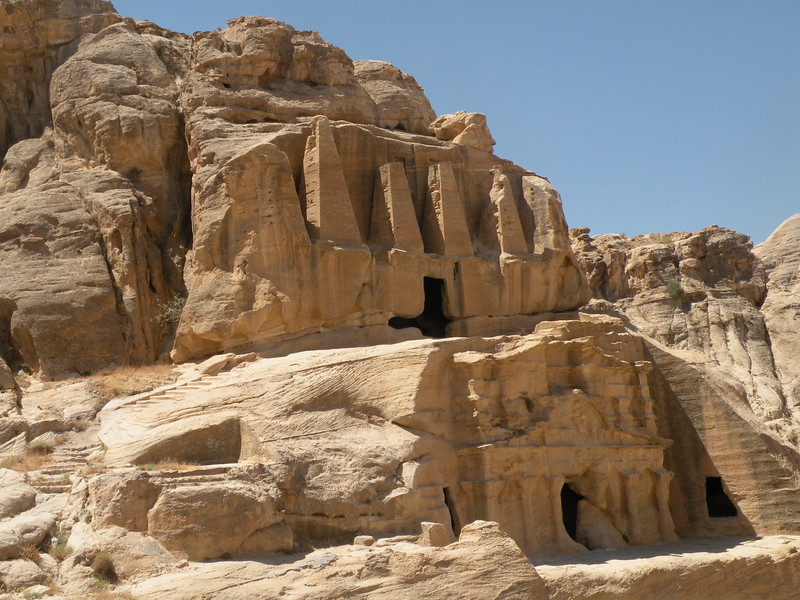 The obelisk tomb and Bab As-Siq Triclinium with four pyramidal obelisks were built as funerary symbols with the eroded human figure in center representing the five people buried in the tomb.