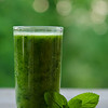 Green Smoothie With Mint As Healthy Summer Drink On Wooden Table