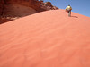 Climbing a red sand dune.  hard work, but worth the effort.