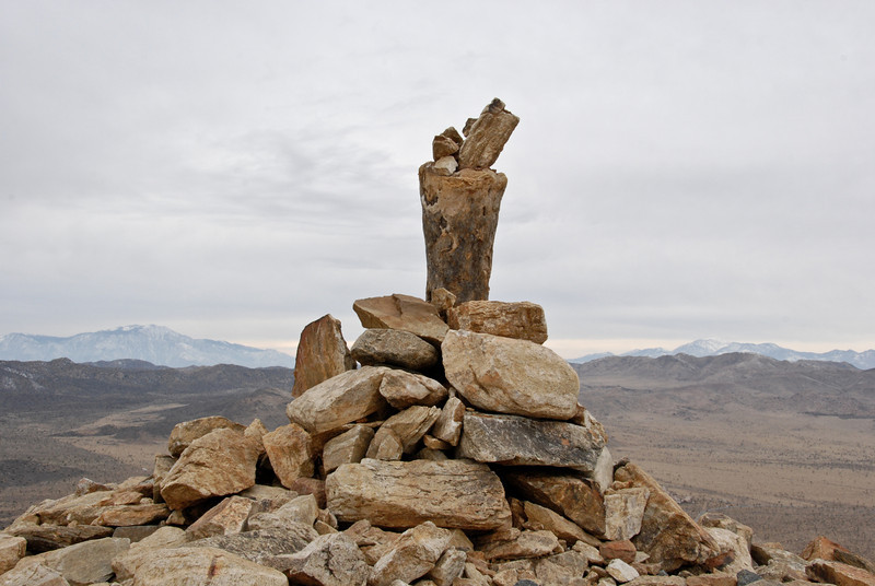 Pile of rocks at the top of Ryan Mountain, and yes, we added a small rock to it. The snowy peaks on the left and right in the distance are San Jacinto and San Gorgonio, respectively.