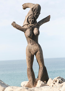 Sculptured statue on beach.