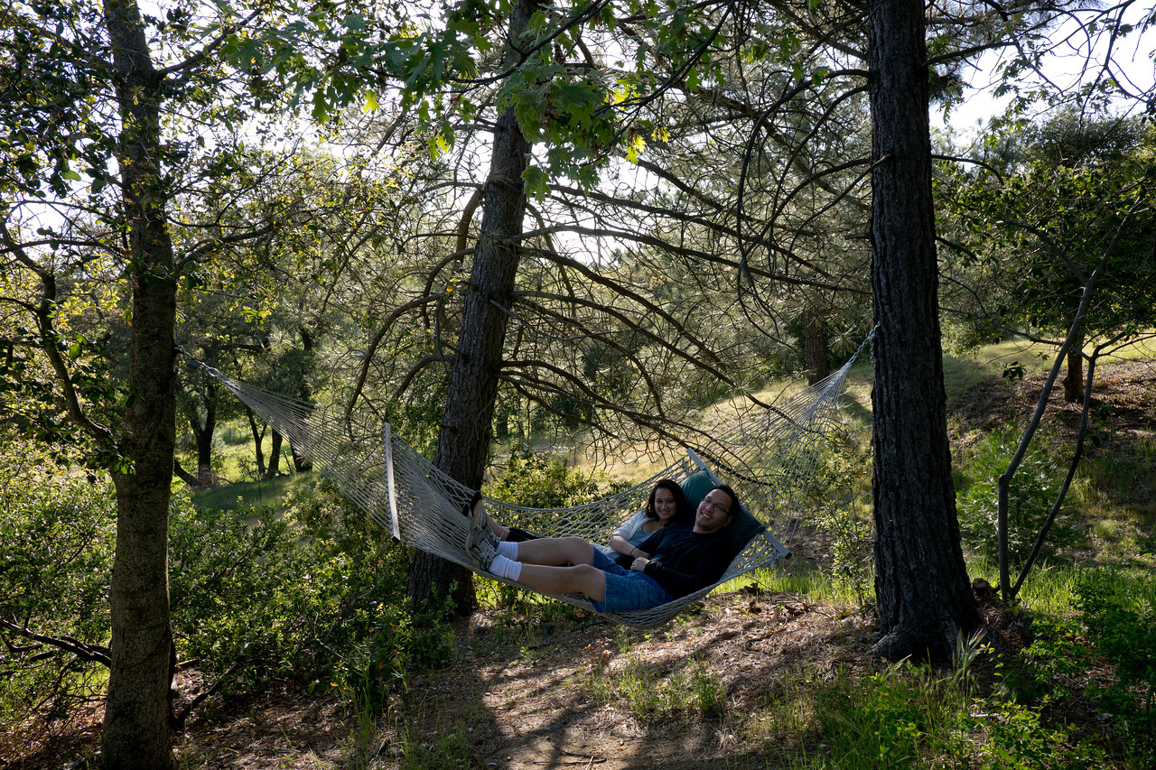 Vu and Catherine on a hammock in front of the Orchard Hill inn. - shot @ ISO 320, f/5.6, 1/400 sec, on Panasonic DMC-GH2 w/ LUMIX G VARIO 7-14/F4 lens at 14 mm