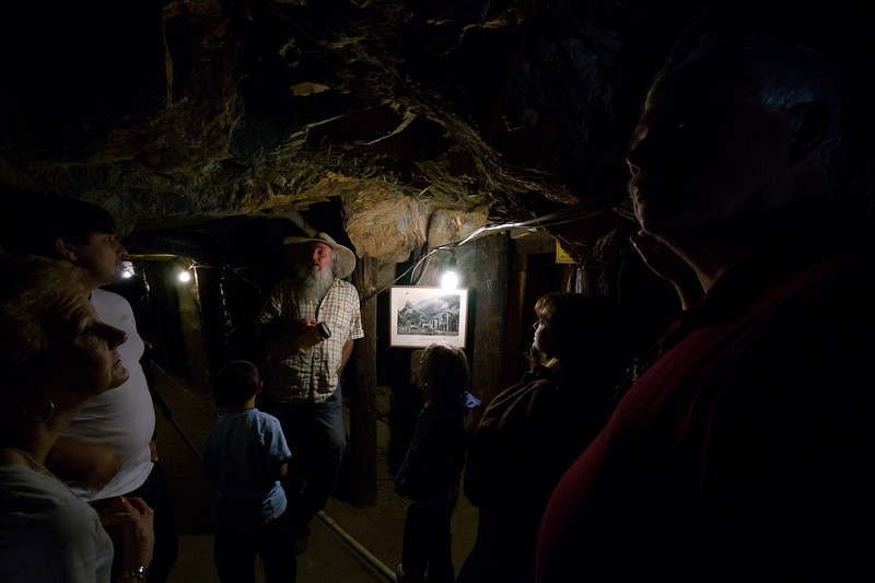 Tour guide Kim explains the history of the Julian gold rush inside the Eagle Mine - shot @ ISO 1600, f/4.0, 1/60 sec, on Panasonic DMC-GH2 w/ LUMIX G VARIO 7-14/F4 lens at 7 mm