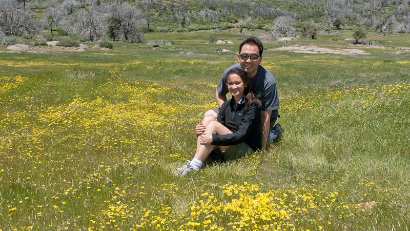 Catherine and Vu in a meadow of flowers off the west side of the 79 between Sunrise Hwy and Lake Cuyamaca. - shot @ ISO 160, f/5.6, 1/1250 sec, on Panasonic DMC-GH2 w/ LUMIX G VARIO 14-140/F4-5.8 lens at 19 mm