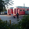 Brian and Brad load th evan past some funky pink train cars, part of a theme restaurant by the motel,