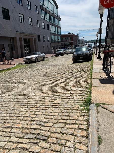 old stone street leading down to the water in Portland