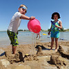 "Coen McCall, 4, pours water on a sand castle, as Ellis Stanzel looks on.<br /> Dozens of people cooled off in the Boulder reservoir on July 15, 2011. For more photos at the Rez, go to  <a href=""http://www.dailycamera.com"">http://www.dailycamera.com</a>.<br /> Cliff Grassmick / July 15, 2011"