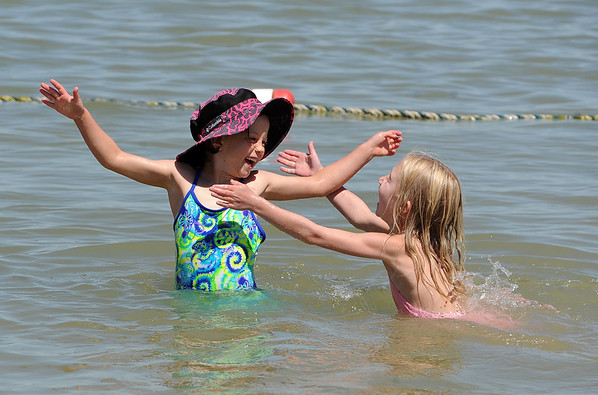 "Ellie Stanzel, left, and Olivia Kurtz, play in the Boulder Reservoir on Friday.<br /> Dozens of people cooled off in the Boulder reservoir on July 15, 2011. For more photos at the Rez, go to  <a href=""http://www.dailycamera.com"">http://www.dailycamera.com</a>.<br /> Cliff Grassmick / July 15, 2011"