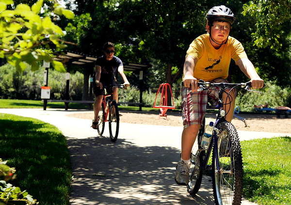 "Will Stoneman, right, rides his bicycle with Peter Wostenberg, left, around Pineview Park on Friday, July 15, in Boulder. For a video of the park go to  <a href=""http://www.dailycamera.com"">http://www.dailycamera.com</a><br /> Jeremy Papasso/ Camera"
