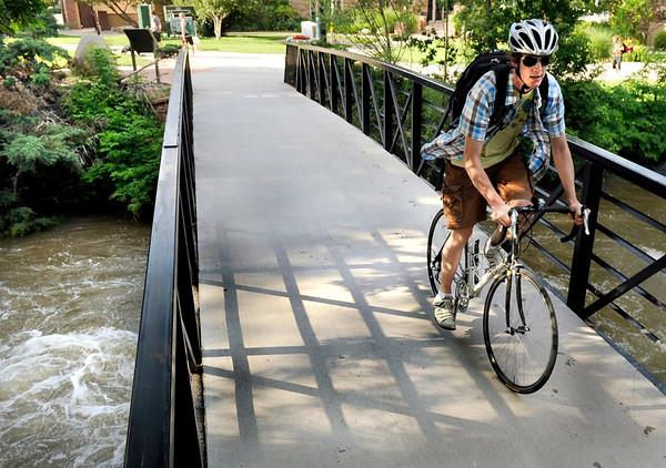 Wade Green, of Boulder, crosses a bridge on the Boulder Creek Trail on Friday, July 15, in Boulder. <br /> Jeremy Papasso/ Camera