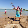 "Ellie Stanzel, 7,  tosses sand as she works on a sand castle at the the Boulder Reservoir on Friday.<br /> Dozens of people cooled off in the Boulder reservoir on July 15, 2011. For more photos at the Rez, go to  <a href=""http://www.dailycamera.com"">http://www.dailycamera.com</a>.<br /> Cliff Grassmick / July 15, 2011"