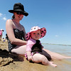 "Alissa Plumley relaxes with her daugher Savannah, 4-months, at the edge of the water on Friday.<br /> Dozens of people cooled off in the Boulder reservoir on July 15, 2011. For more photos at the Rez, go to  <a href=""http://www.dailycamera.com"">http://www.dailycamera.com</a>.<br /> Cliff Grassmick / July 15, 2011"