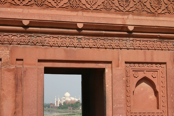 Exquisite carving with Taj Mahal through the window.