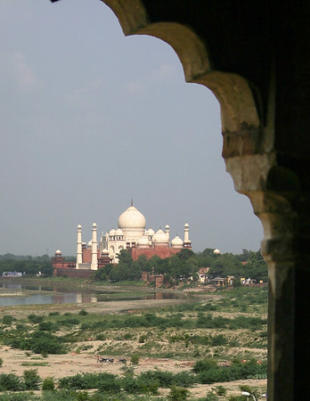 Back of Taj Mahal through arched window from down river.