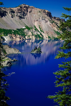 """The bluest blue """"Phantom Ship"""" Crater Lake, Oregon  The island appears small, but there are full grown evergreen trees on it. Post-processing note:  Pictures take with a circular polarizer.  Color and saturation were not adjusted.   It's really blue!"""