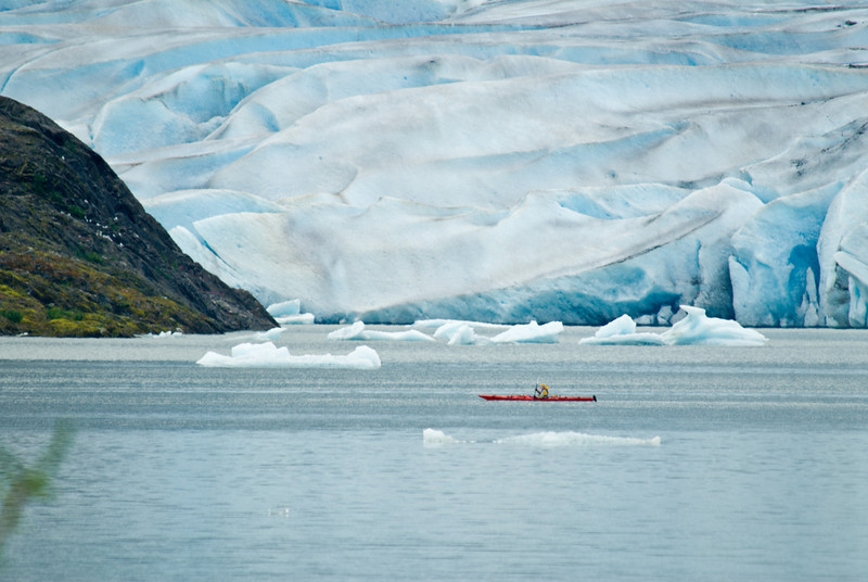Kayaker next to the Mendenhall Glacier, Juneau AK.