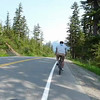 Biking along the Eaglecrest road at Douglas island in Juneau, Alaska.