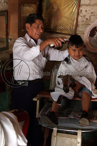 "Got to look good! Notice the little horse that he is ""riding"" while getting his haircut. Ataco, El Salvador"
