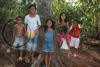 While I was taking this photo Paco standing next to me making these kids laugh. Thus, most of their eyes are looking to my right. The little boy in the far right is so cute! Talnique, EL Salvador