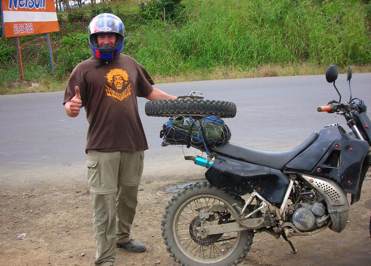 Helping a fellow biker repair a flat tire