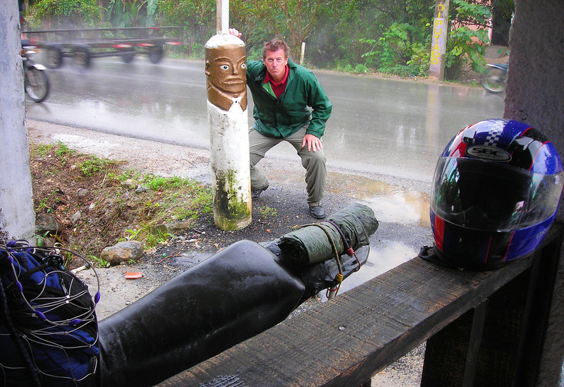 Asking a Tiki face for advice while waiting out a rain storm