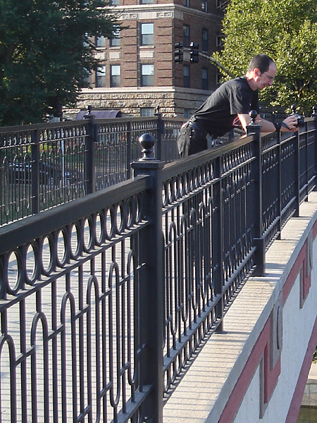 Ilan on a footbridge over a canal running through the city.