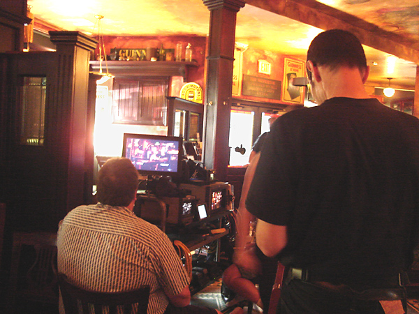 I take a photo, of Ilan taking a photo, of a crew member who sits watching the monitor feed from the HD Video camera that is being used to shoot the documentary.