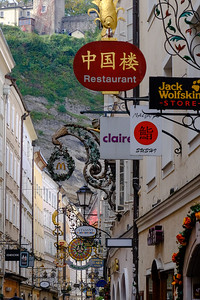 The wrought-iron signs of Getreidegasse in Salzburg's city center are a requirement by city code and date from the Middle Ages when an illiterate populace needed pictorial aids.