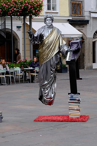"The square outside the abbey cloister is a mecca for tourists and those who make money from them. One of the newest tourist ""attractions"" are performers who rig costumes that permit them to appear to levitate. This gentleman would have you believe that he is a reincarnate  Mozart."