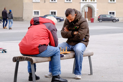 The square just outside the cloister of the abbey is a gathering place for tourists as well as locals. These two look as if they have matched wits at chess many times before.