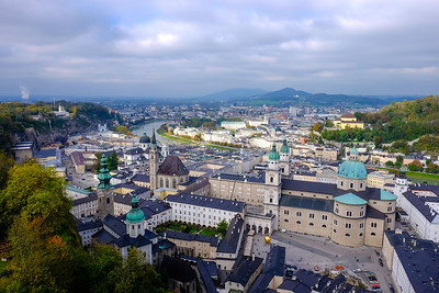 The City of Salzburg from the vantage point of the Festung Hohensalzburg (High Fortress of Salzburg). Visible near the center of the frame are the twin belfries of Dom Salzburg (Salzburg Cathedral). The city is bisected by the Salzach River, which derives its name from its use as a means of shipping salt from nearby mines (a fact which also explains the city's name).