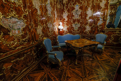 The Millions Room takes its name from the precious wall paneling made from an exotic type of rosewood. This room was originally intended for the Belvedere Palace but was transferred intact in 1766 on orders of Empress Maria Theresa. The inlaid miniatures show scenes from the life of Mogul rulers in India in the 16th and 17th centuries. During World War II, the Millions Room paneling was dismantled and taken to be stored in salt mines in Altaussee. In the 1980s, it was determined that the miniatures were extremely sensitive to light. As a result, they were removed and placed in protective storage. In their places are the high-quality facsimiles that you see here.