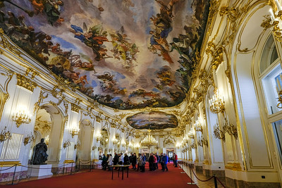 "One hundred forty feet wide by nearly 33 feet wide, Schönbrunn Palace's Great Gallery was the setting for court festivities such as balls, receptions and banquets. The ceiling fresco by Baroque-era Italian artist Gregorio Guglielmi (1714-1773) represents the prosperity of the monarchy under the rule of Maria Theresa (1717-1780), the only female monarch of the Austrian empire. It was in this room in June 1961 that Soviet premier Nikita Kruschev and newly-elected U.S. president John F. Kennedy met in what was called the ""Vienna Summit."" Kennedy, together with many historians, believed that Kruschev got the better of Kennedy at the meeting."