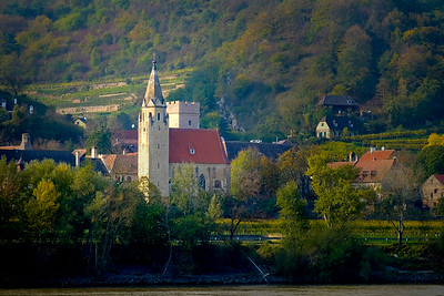 The Wachau Valley between Melk and Krems attracts epicureans from all over the world with its famous wines. The valley was placed on the list of UNESCO World Heritage Sites in 2000. This church just downriver from Melk is overlooked by a terraced vineyard.