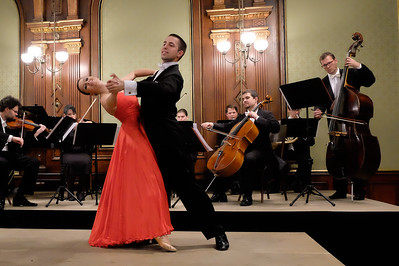 The advent of the waltz marked an enormous change in the way men and women danced in polite society. Prior to the waltz, all European social dances were communal sequence dances -- communal because all the dancers on the floor took part in a pre-set pattern. With the waltz, couples were independent of other couples, and were turned towards one other. As the waltz evolved, the contact between the man and the woman became close (which was considered scandalous in some quarters). The Congress of Vienna in the early 19th century, together with the famous compositions by Josef Lanner, Johann Strauss I and his son, Johann Strauss II, helped popularize the waltz around the world.