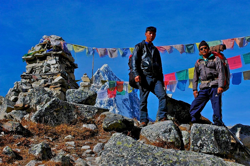 Sherpas on cemetery of lost sherpas during expeditions near Lobuche, Nepal