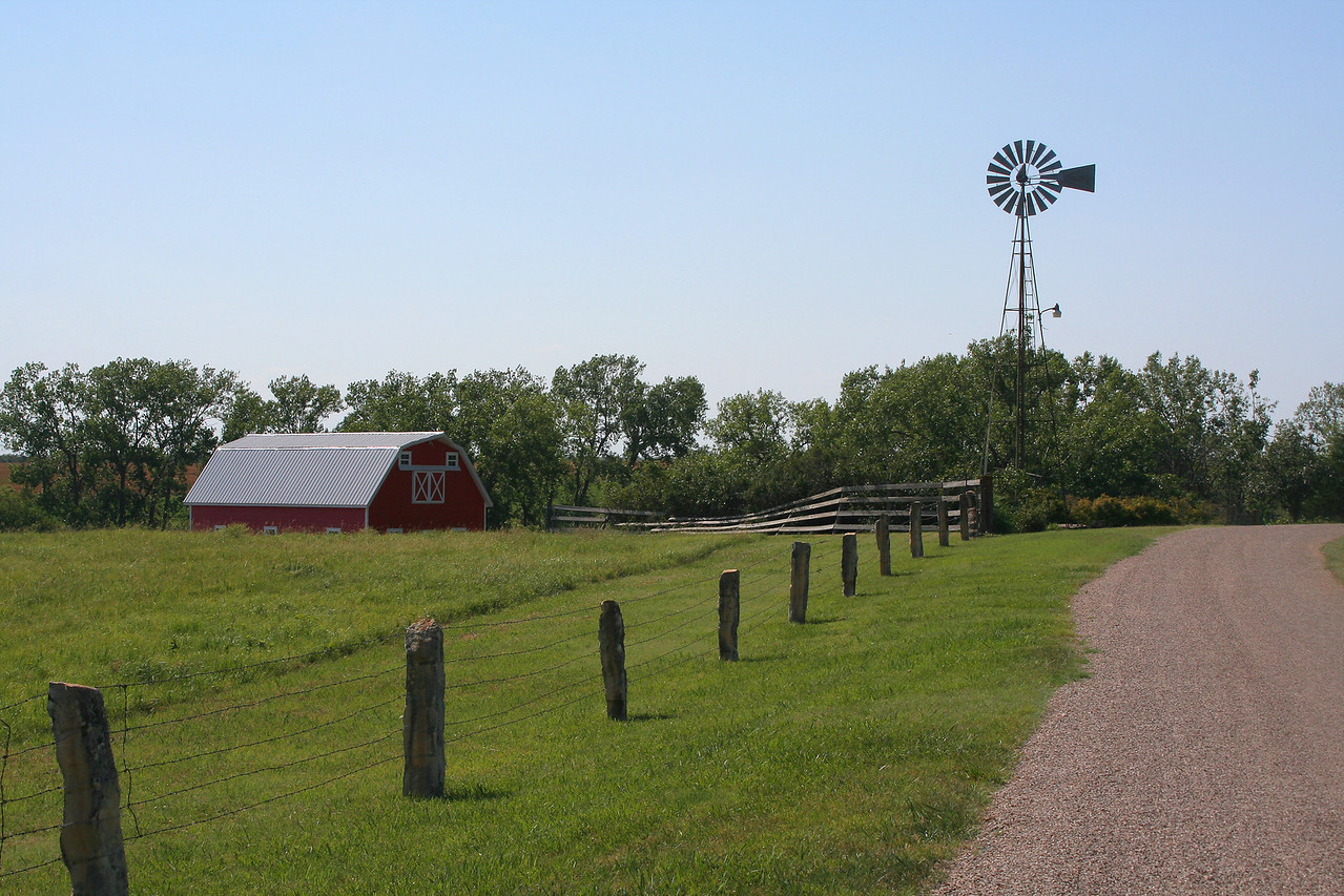 Red barn, fence, windmill. Kansas.