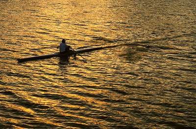 Rower at sunset on the Arkansas River, Wichita, Kansas.
