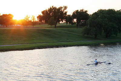 Rower at sunset on the Arkansas River, Wichita, Kansas.