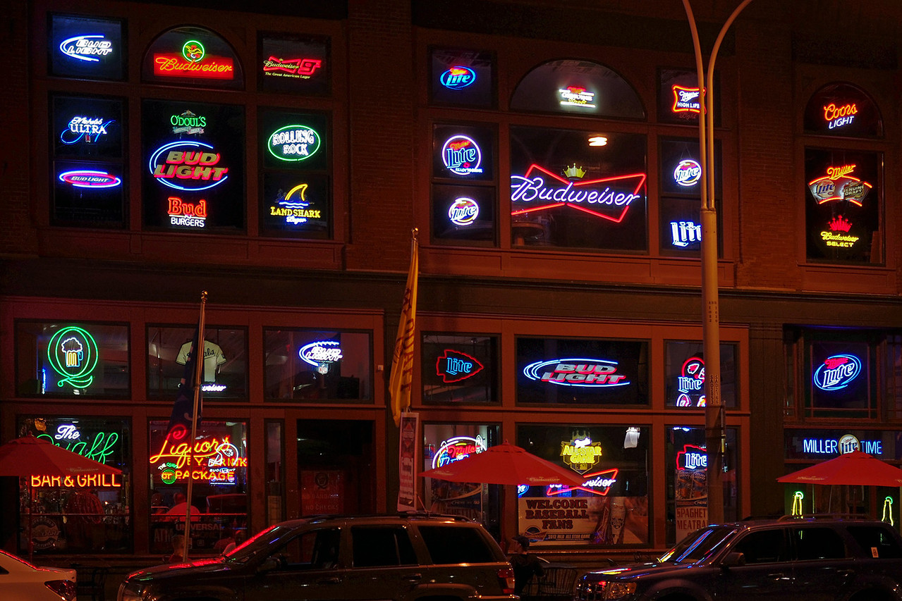 Beer neons at night. The Quaff Bar and Grill, 1010 Broadway Blvd, Kansas City, Missouri.