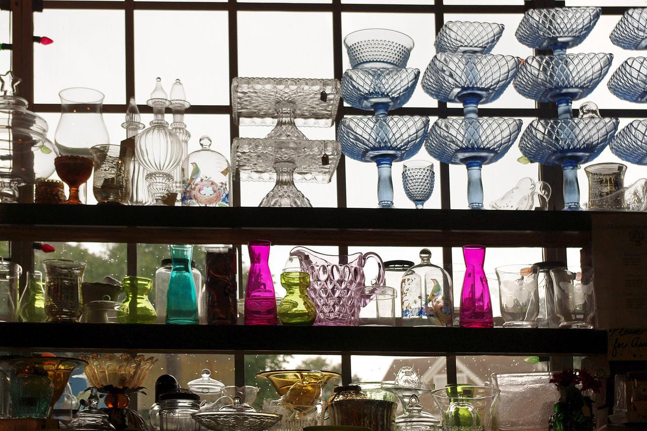 Glass display in shop window, Pryde's. Old Westport, Kansas City, Missouri.