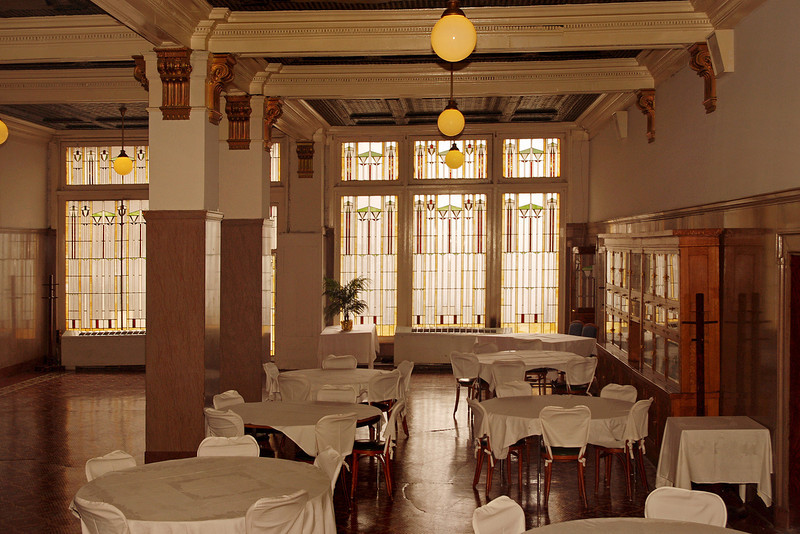 "Dining room, Hotel Savoy, Kansas City, Missouri. From their website:<br /> <br /> ""The Hotel Savoy was built on the corner of Ninth and Central streets in 1888 ... It offered turn-of-the-century elegance to political and stage personalities as well as cattlemen, grain merchants and travelers heading west. ... In 1903, it was remodeled and the west wing was added along with The Savoy Grill dining room. Imported marble and tile, brass fixtures and stained glass are some of the original features of the hotel decor. Art Nouveau style stained glass in the skylight was designed in Kansas City by Frank Anderson for the hotel lobby."""